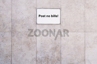 prohibition sign post no bills on marble stone wall background