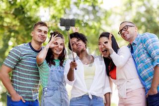 international friends taking selfie in park