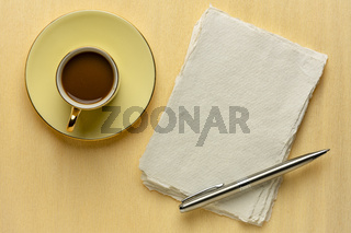 blank sheet of rag paper with coffee