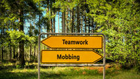 Street Sign to Teamwork versus Mobbing