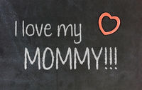 Blackboard with small red heart - I love my mommy!