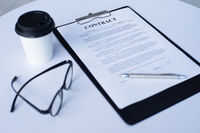 Business contract on table