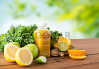 bottle with orange juice, fruits and vegetables