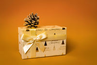 Christmas gift box on orange background