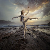 Ballet dancer in a sunset on the beach. concept freedom and nature in its purest state