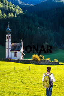 Woman-tourist with backpack in Dolomites