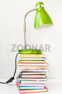 Table lamp and a stack of books