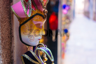 Traditional venetian mask in store on street