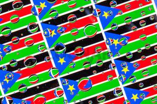 Rain drops full of South Sudan flags