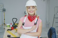 Female construction worker standing at workbench