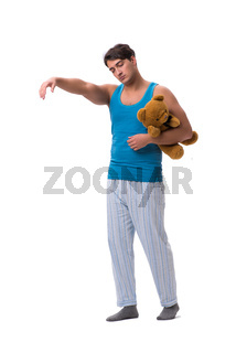 Young man in pajamas with toy animal isolated on white backgroun