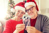 close up of happy senior couple at christmas