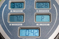 The display panel on the exercise machine. The display shows speed, time, distance and burned calories on the training machine.