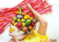 Young woman and exotic fruits on the tray