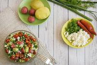 Salad with radish, potatoes, green onions, dill.