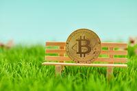 Bitcoin Münze als Geldanlage auf Bank