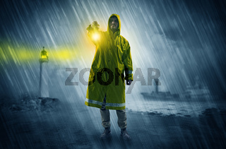 Man coming with lantern at coast concept