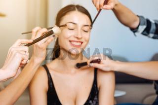 cute, young girl doing makeup
