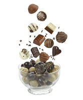 Assortment of chocolate candies on white background