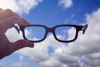 Hand glasses sky