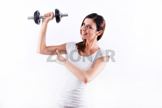 Young woman showing muscles