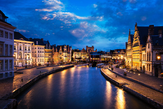 Graslei street and canal in the evening. Ghent, Belgium