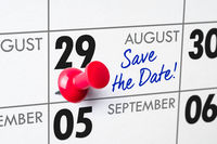 Wall calendar with a red pin - August 29