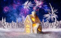Kleines Haus mit Winterlandschaft und Feuerwerk