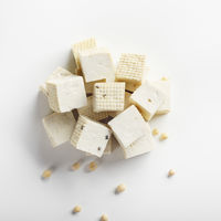 Soy Bean curd tofu on white background Non-dairy alternative substitute for cheese