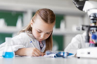 girl studying chemistry at school laboratory