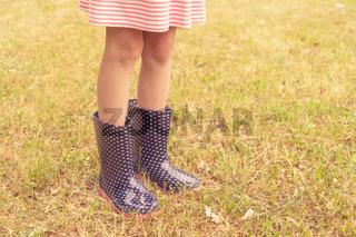 Girl wearing rain boots