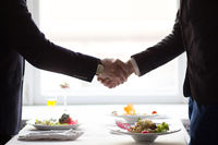 businessman shaking hands before business lunch