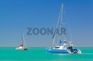 Catamarans, green water and blue sky - Monkey Mia