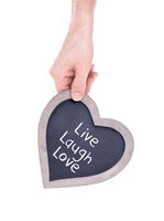 Adult holding heart shaped chalkboard - Live laugh love
