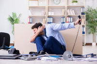Businessman frustrated at many telephone calls