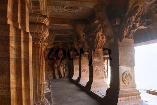 Badami Caves, Karnataka, India. Cave 3 : Carved figure of Vishnu as Narasimha, half human, half lion. Brackets of pillars, has carvings of human figures standing under foliage in different postures