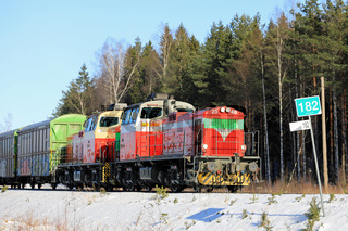 Two Diesel Engines in Front of Freight Train