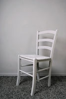 empty vacant chair in gray room