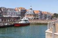 Harbor Dutch city Vlissingen with pilot boat ready for departure