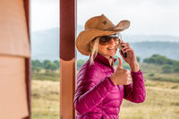 RUOK Happy woman at rural ranch with thumbs up gesture