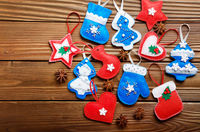 Handmade rustic felt Christmas tree decorations with anise on wooden table