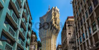 Streets of Macau. Contrast between old and modern buildings.