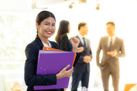Asian Businesswoman hold working file