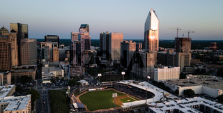 Ball Game at Sunset with Sunlight Reflecting of High Rise Architecture in Charlotte