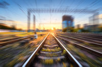 Railroad with motion blur effect at sunset