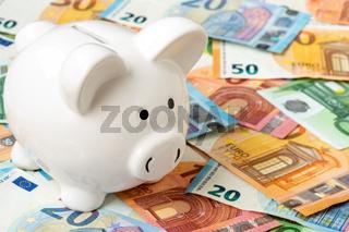 Piggy moneybox with euro cash closeup