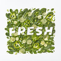 Fresh spinach, cabbage, asparagus pieces of pepper, cucumber and flower petals on a gray background. A set of organic vegetables for dietary salad. Flat lay