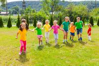 Runnig children at summer camp in the summer outdoors