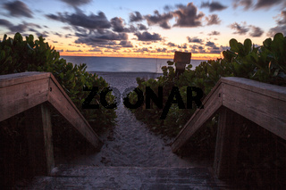 Boardwalk entrance of the Naples Beach at sunset