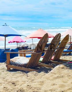 Beach chairs, sacks, umbrellas. Bali